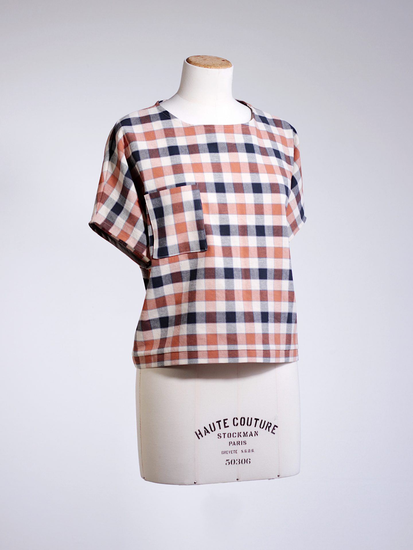 navy/orange checkered tee
